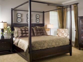 Spacious suite with four post bed, relaxing natural tones, and fresh picked flowers next to the bed