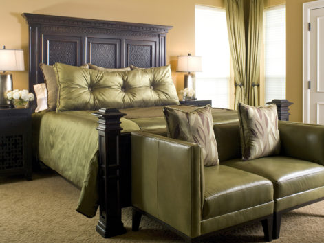 Elegant suite with green silk king bed and green leather loveseat