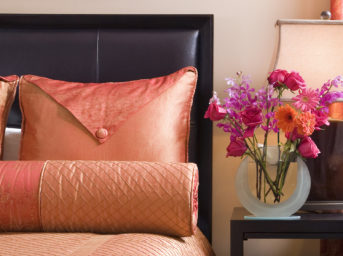 Luxurious bed in guest room with fresh picked flowers